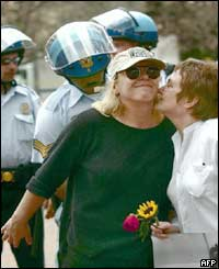 Nobel Peace Prize winner Jodi Williams receives a kiss on the cheek by fellow Nobel laureate Mairead Corrigan Maguire  in Washington