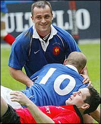 France Thomas Castaignede celebrates with fly-half Frederic Michalak