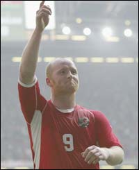 John Hartson celebrates after scoring Wales' third goal