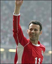 Ryan Giggs celebrates scoring Wales' fourth goal