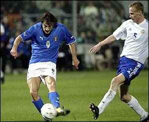 Italian forward Christian Vieri scores against Finland