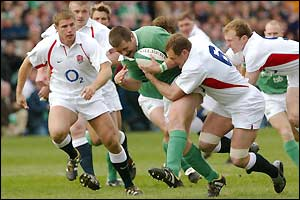 Marcus Horan of Ireland is hauled down by Richard Hill