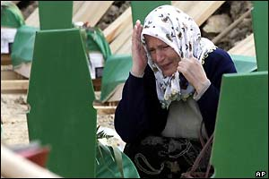A Bosnian Muslim woman weeps at a grave