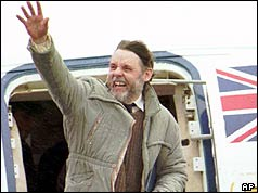 Terry Waite arriving at RAF Lyneham airbase in the UK