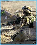 A British Paratrooper prepares for patrol in southern Iraq