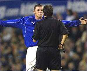 Wayne Rooney pleads his innocence to the referee
