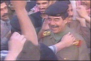 Iraqi TV picture showing Saddam Hussein being greeted by a supporter