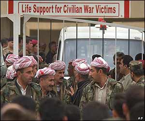 Kurdish fighters gather outside a hospital in the main Kurdish-controlled town of Irbil