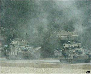 US tanks outside Saddam Hussein's presidential palace, on the river Tigris