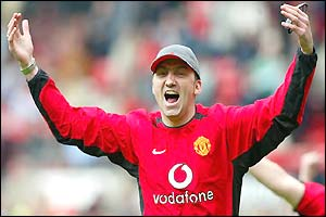 Karl Power wearing a Manchester United shirt
