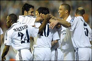 Real Madrid's players congratulate Luis Figo