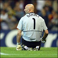 Fabien Barthez sits on his knees after Raul scores again for Real Madrid