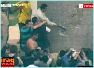 The crowd used hammers and rope to try and topple the statue