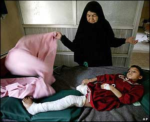 Nine-year-old Zeinab Hazed is tended to by her grandmother as she lies in Basra General Hospital