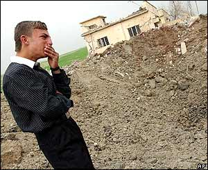 Kurdish man Khalid Jasem cries next to his home near Mosul before it was destroyed