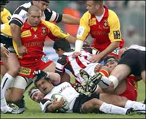 Toulouse number eight Christian Labit (centre) finds himself under pressure