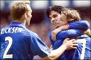 Rangers players celebrates Claudio Caniggia's goal