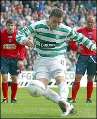 Celtic midfielder Alan Thompson misses a penalty