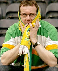 A Celtic fan at Kilmarnock sees the SPL title slipping away