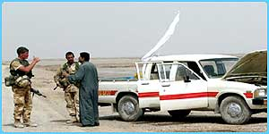 Iraqis being stopped at an army checkpoint