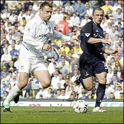 Mark Viduka evades the challenge of Spurs' Steve Carr to score the opening goal at Elland Road