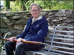 Michael Westmacott in 2003 with the ice axe he used on the 1953 expedition