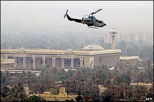A US attack helicopter flies over one of Saddam Hussein's presidential palaces in Baghdad, 13 April 2003