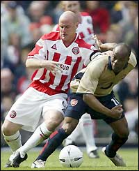 Robert Page challenges Arsenal's Sylvain Wiltord