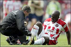 Wayne Allison receives treatment on his injury