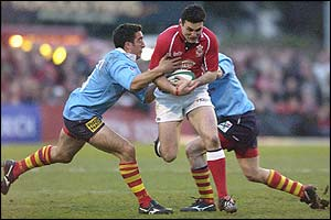 Llanelli's Stephen Jones is tackled by Perpignan's Gregory Le Corvec