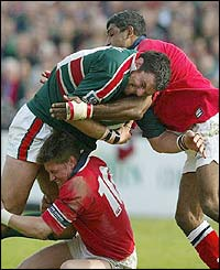 Leicester captain Martin Johnson battles to try and gain ground