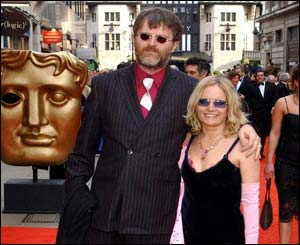 A bearded Paul Merton, with partner Sarah Parkinson, had complained he never wins Baftas