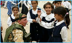 British soldiers talk to Iraqi schoolgirls in Basra