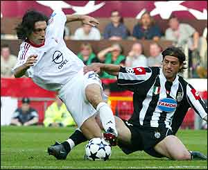 AC Milan's Andrea Pirlo, left, is tackled by Juventus' Alessio Tacchinardi