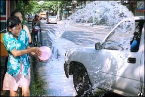 Girl throws water at car