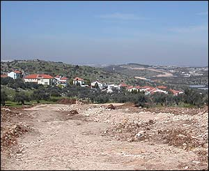 Israeli excavation stretching to the horizon and passing the settlement of Sharah Tikva