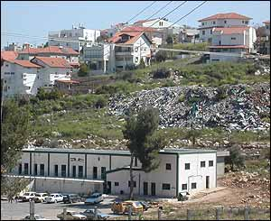 Palestinian school abutting Shareh Tikva, with the settlement's rubbish tip between them