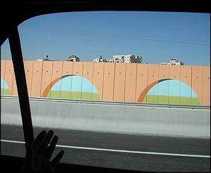Painted 'sniper wall' separating the town of Bir Nabala from bypass road used by Jewish settlers