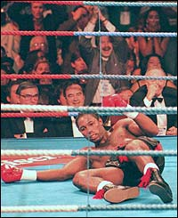 Lennox Lewis is knocked out in the second round by Oliver McCall
