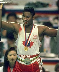 Lennox Lewis celebrates after receiving the gold medal during the 1988 Olympics Games