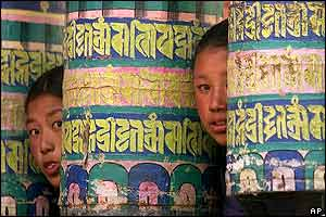 Peeping between Buddhist prayer wheels at Tyang Boche monastery where some celebrations were held