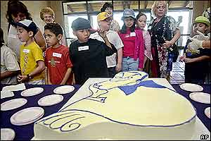 Schoolchildren also gathered to admire a cake honouring Hope's centenary
