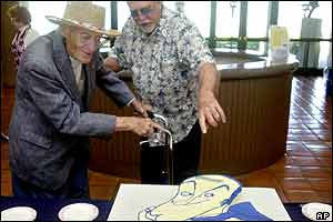 Two Bob Hope fans admire a cake at the Ronald Reagan Presidential Library and Museum in California