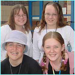 Twins Emma and Jenny (back row) and pals Rebecca and Libbi, all 12, wanted Dane D-Side to show them his muscles!