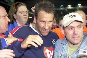 Paul Merson and Pompey fans celebrate promotion
