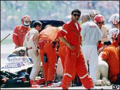 Medics attend to Ayrton Senna after the accident
