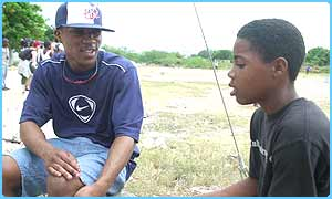 Asher D talks to a child in Bennett land, Jamaica