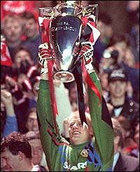 Peter Schmeichel lifts the Premiership trophy in May 1993