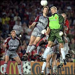 Peter Schmeichel challenges for a header in the Bayern Munich penalty area during the Champions League final in May 1999