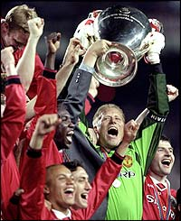 Schmeichel holds the Champions League trophy aloft after a 2-1 success over Bayern Munich in May 1999